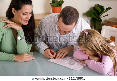 mother, father and daughter together - stock photo