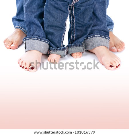 Mother, father and little child wearing blue jeans, barefoot people legs isolated on white background, body part, family togetherness concept - stock photo