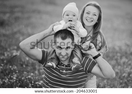 Mother father and lovely daughter. Summertime. - stock photo