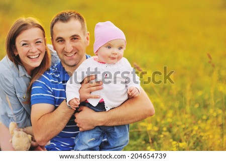Mother father and lovely daughter. Summertime. Happy family concept. - stock photo