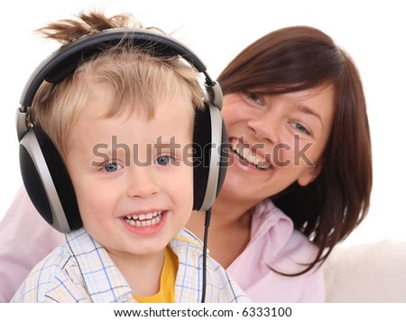 mother father and son listen to music - leisure activity