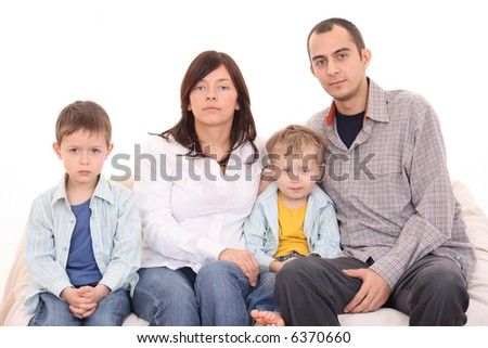 mother father and two sons on the sofa - family - stock photo