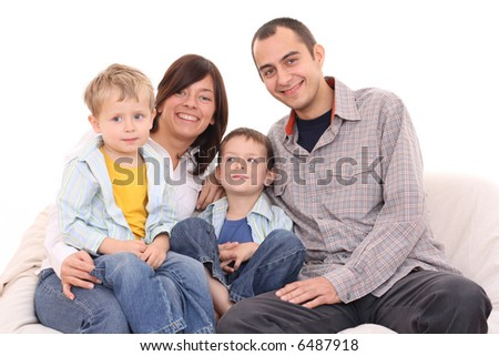 mother father and two sons on the sofa - happy family
