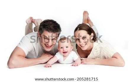 Mother Father Baby Boy Lying on Studio Floor Isolated. Studio shot on white background. - stock photo