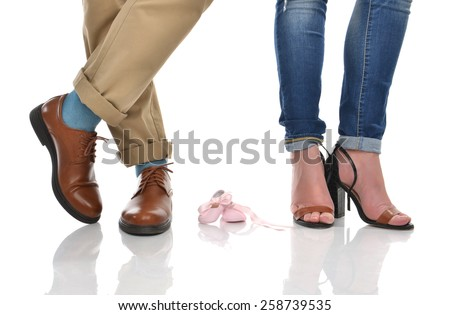 Mother father baby feet shoes on the floor waiting for baby concept isolated on a white background - stock photo