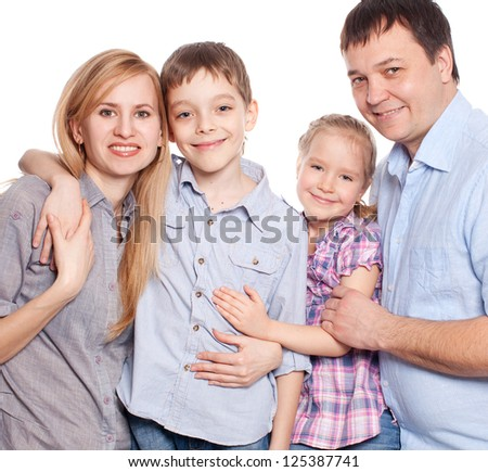 Mother, father, son and daughter isolated on white background. Happy family. Parents with children.