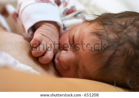mother feeding - stock photo