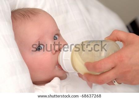 Mother feeding baby - stock photo