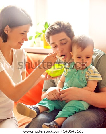 mother feeding baby. He refusing. bad appetite - stock photo