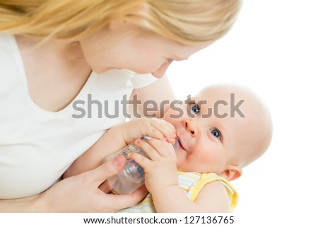 mother feeding from bottle her adorable baby boy - stock photo