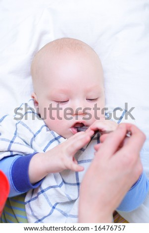 Mother feeding her baby - stock photo