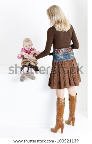 mother feeding her little daughter - stock photo