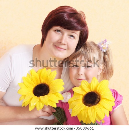 mother girl with flowers - stock photo