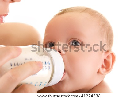 Mother give drink her baby boy by feeding bottle