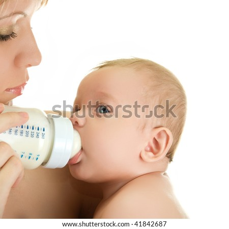 Mother give drink her baby boy by feeding bottle over white