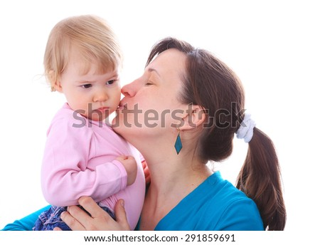Mother give kiss for her child, isolated on white in studio - stock photo