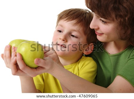 Mother gives son an apple - stock photo