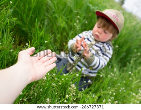 Mother giving a hand to her son - stock photo