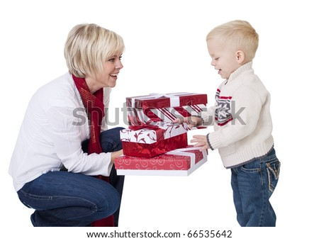 Mother Giving Christmas Presents to her Child - stock photo