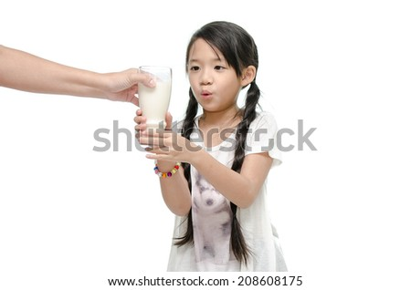 Mother giving her daughter a glass of milk - stock photo