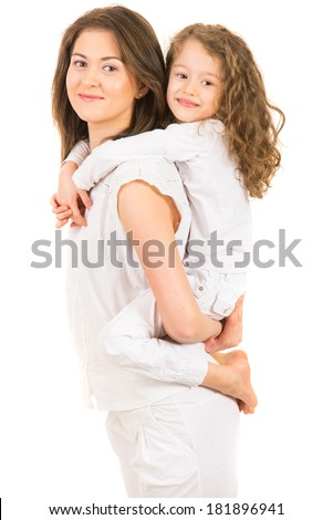 Mother giving piggyback ride to her daughter and being in motion isolated on white background