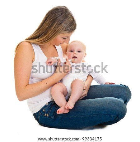 Mother giving vitamins to infant girl isolated on white