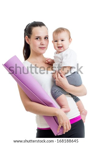 Mother going to do fitness exercises with her baby - stock photo