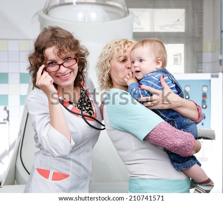 Mother, granny and little boy in hospital  - stock photo