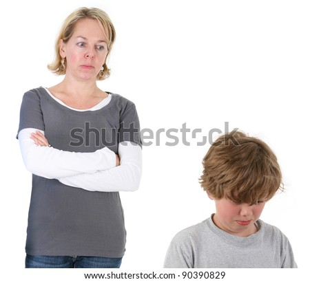 Mother having discipline issues with son - stock photo