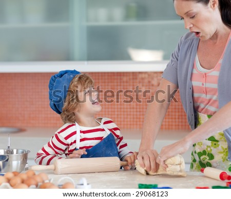 Mother having fun with her child - stock photo