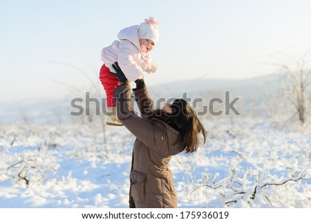 mother having fun with her smiling child - stock photo