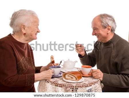 Mother having tea with her son on a white background - stock photo