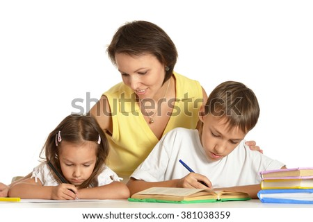 Mother help children do their homework isolated on white background - stock photo