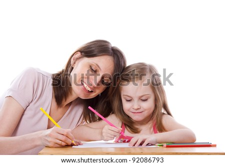Mother helping daughter to draw isolated on white - stock photo