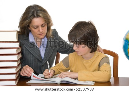 Mother helping her child with homework - stock photo