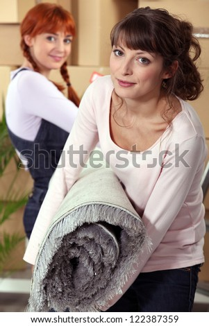 Mother helping her daughter move - stock photo