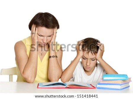Mother helping her son doing homework - stock photo
