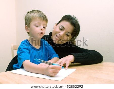 Mother helping son with homework - stock photo