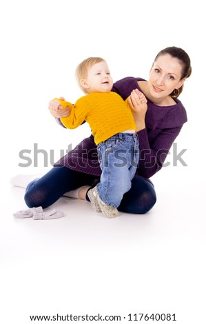 mother helps to do the first steps of the child isolated on white background
