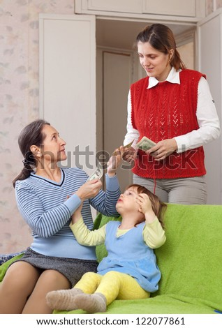 Mother hires governess for her child - stock photo
