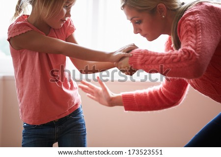 Mother Hitting Young Daughter - stock photo