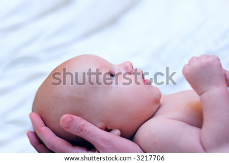 Mother hold baby in hands - stock photo