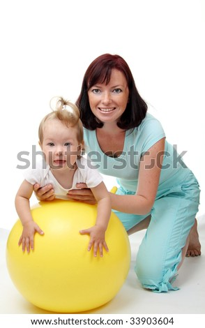 Mother hold daughter on Fitness Ball - stock photo