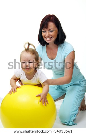 Mother hold daughter on Fitness Ball