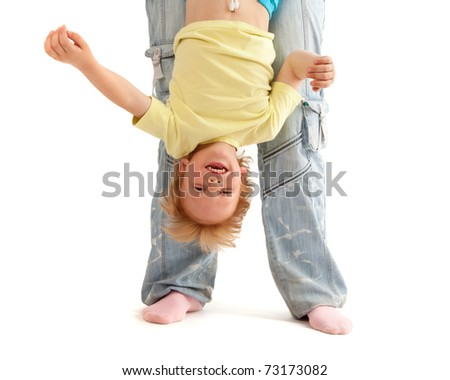Mother hold her smiling son upside down. Isolated on white - stock photo