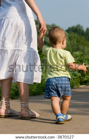Mother hold son's hand - stock photo