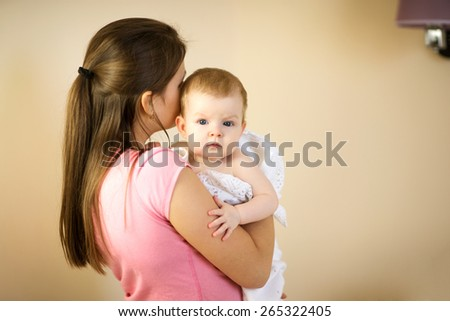 Mother holding a baby in a blanket