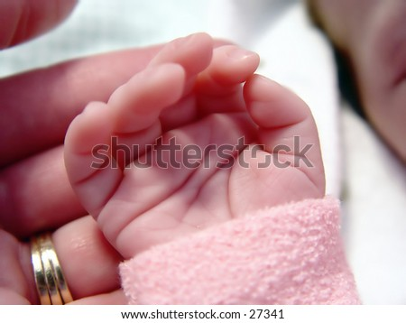 Mother holding babies hand