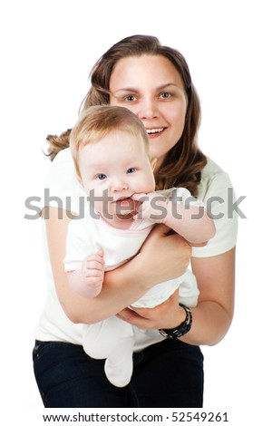 Mother holding baby in her arms - stock photo