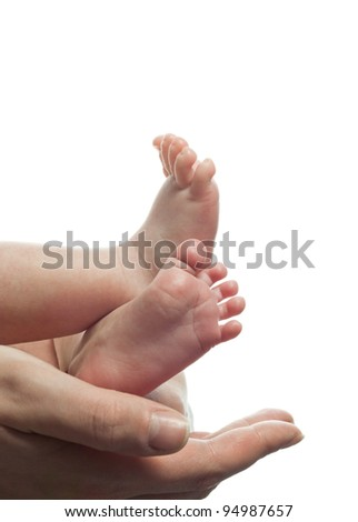 mother holding baby's foot closeup isolated on white - stock photo